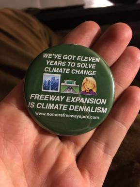 "Image Shows one of our new buttons, with the text ""We've got eleven years to solve climate change; freeway expansion is climate denialism"""